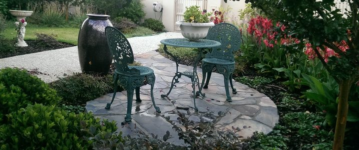 An informal garden with rustic slate paving and diverse plantings